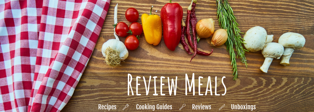 A cutting board with vegetables and the words review meals